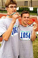 Athletes displaying there winning medals, Special Olympics, U of M Bierman Athletic Complex, Minneapolis, Minnesota, USA