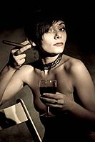 Naked woman with cigarette and glass of wine