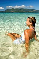 Woman age 23 enjoying the warm turqoise waters at a beach  Tropical holiday on remote island  Storm Island near Beqa Lagoon, Beqa Island, Fiji