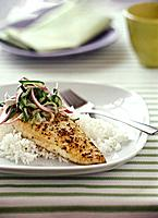 Grilled mustard fish with vegetable decoration