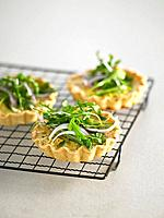 Salmon quiches with herbs on grill