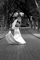 Bride walking down driveway, rear view