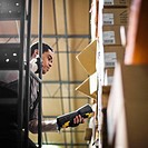 Warehouse Worker Scanning Inventory