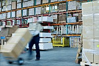 Warehouse Worker Using Dolly