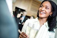 Businesswoman Drinking Champagne at a Party