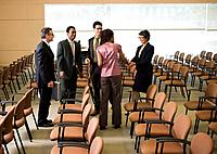Businesspeople Talking in Conference Room