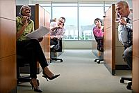 Businesspeople Irritated by Loud Cowork in Cubicle