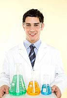 Scientist with flasks of fluid