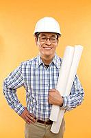 Man with hardhat and plans
