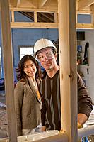 Hispanic couple at new construction site