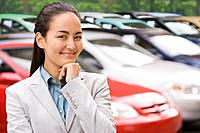 Asian businesswoman on new car lot