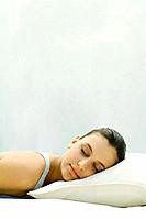 Woman resting head on pillow, eyes closed (thumbnail)