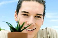 Young man with plant