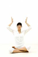Woman meditating with sphere over head