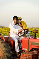 A rural couple on a tractor