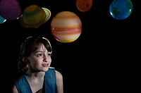 Portrait of a girl and planets