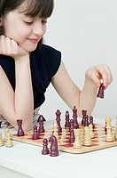A girl playing chess