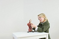 A girl with an anatomical model