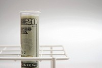 American banknote in a test tube