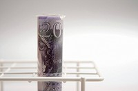British banknote in a test tube