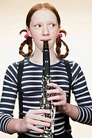Portrait of a girl playing a clarinet