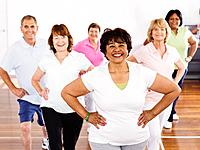 Multi_ethnic adults taking exercise class