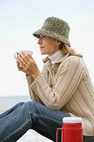Woman having a hot drink