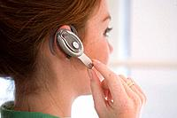 Woman with hands free device, side view