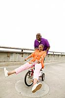 Senior African couple playing on tricycle