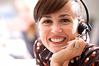 Woman with headset, smiling, portrait