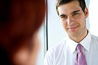 Businessman looking at co-worker
