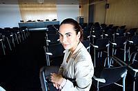 Businesswoman waiting in empty lecture hall