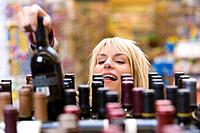 Woman choosing a bottle of wine