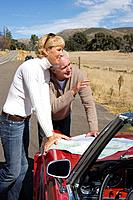 Couple looking at map on road trip