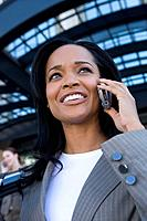 Businesswoman talking on cell phone in urban setting