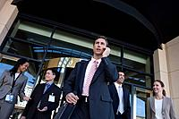 Group of business people exiting building