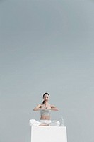 Young woman practising yoga