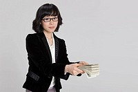 Businesswoman holding paper currency, close_up