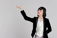 Businesswoman with raised hand, close_up