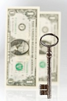 Key with paper money in background, close_up
