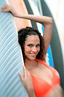 Female young adult posing with surfboard (thumbnail)