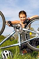 young woman repairing her mountainbike