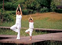Mother and Daughter Doing Yoga Outdoor,Korea