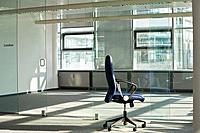 still of chair in empty office space