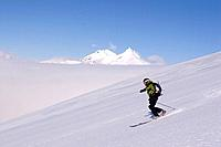 A man skiing on a glacier on Mount Vsesevidov in the Aleutian Islands in Alaska