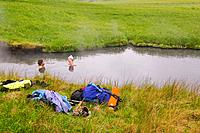 A couple in a hot springs on Umnak Island in the Aleutian Islands in Alaska