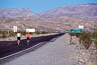 2 women running on a road in Death Valley CA