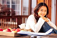 Young Korean Woman with Apples