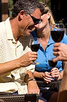 A happy couple smiling and drinking wine at Northstar ski resort near Lake Tahoe in California