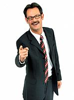 Man wearing suit pointing with a fnger to the camera